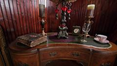 Victorian Style Antiques on Kidney Desk in Historic Parlor in the American West Stock Footage