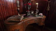 Stock Video Footage of Victorian Style Antiques on Kidney Desk in Historic Parlor in the American West