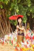 woman with religion flag at temple - stock photo