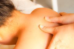 Reflexology shoulder massage, spa the shoulder treatment,thailand Stock Photos