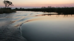 Boat on Kwando river at sunset, Caprivi region, Namibia Stock Footage