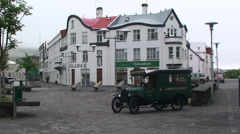 Old town square with an ancient classic car Stock Footage