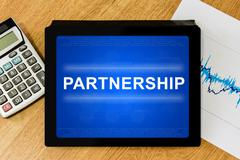 Partnership word on digital tablet Stock Photos