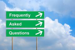 Frequently asked questions or faq on green road sign Stock Photos