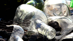 Some broken bottles on the garbage area Stock Footage