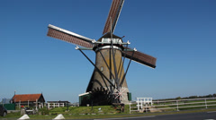 A working Dutch windmill and a water wheel - stock footage