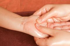 Reflexology hand massage, spa hand treatment,thailand Stock Photos