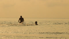Friends swimming in the sea Stock Footage