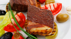 Steak garnished with baked apples Stock Footage