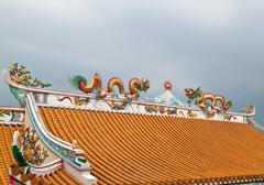 Dragon sculpture on roof of chinese shrine,east of thailand Stock Photos