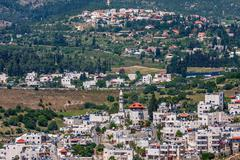 palestinian village on the hills in israel. - stock photo