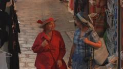Tourists,  walking in the narrow streets of Lindos, Rhodes, Greece Stock Footage