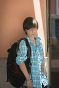 teen boy with rucksack on travel - stock photo
