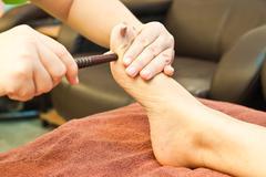 Reflexology foot massage, spa foot treatment,thailand Stock Photos