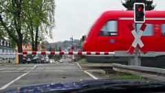 German train passing a railroad crossing in Thuringia, Germany Stock Footage
