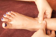 Reflexology foot massage, spa foot treatment,thailand Stock Photos