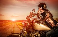 biker girl on a motorcycle - stock photo