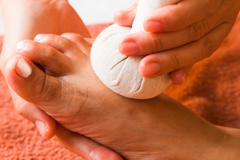 Reflexology foot massage, spa foot treatment by ball herb,thailand Stock Photos