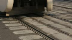 Clse view of city tram rails when a tram passes by Stock Footage