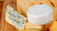 Delicious cheeses on wood Stock Footage