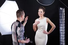 Photpgrapher telling compliment to his model Stock Photos