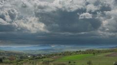 Transylvania Turzii Gorge during storm in distance sun over meadows HD Stock Footage