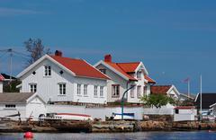 white wooden houses in lyngor - stock photo