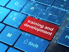 Education concept: Training and Development on computer keyboard Stock Illustration