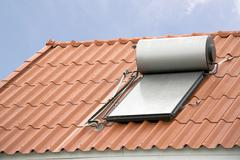Solar panel for hot water system on roof Stock Photos