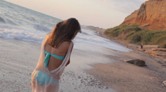 Happy girl walk along sealine. Smile Stock Footage