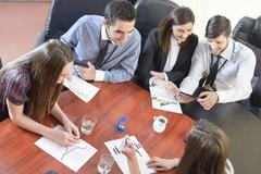 business people having board meeting - stock photo