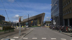 Rotterdam Centraal railway station + tram passing Stock Footage