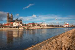 Magnificent cathedral of magdeburg at river elbe with blue sky, germany Stock Photos