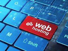 Stock Illustration of Webdesign concept: Gears and Web Hosting on computer keyboard b