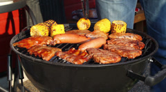 Meat and corn grill on a barbecue Stock Footage