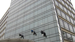 Commercial Building Window Cleaners at Work Stock Footage