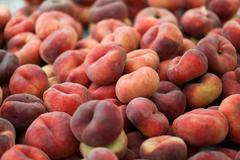 Saturn peach or chinese flat peaches Stock Photos