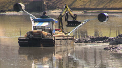 Floating Excavator amphibian on lake water surface Stock Footage