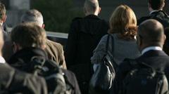 Large crowd of pedestrians walk over London Bridge 24. 4K version Stock Footage