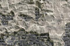 old crumbled black and gray wall background - stock photo