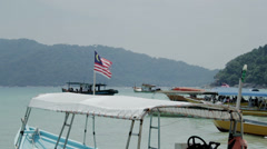 A Malaysian flying flag on a boat (Malaysia - Perhentian islands) Stock Footage