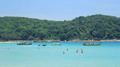 Departure of a boat from the beach to bring food (Malaysia - perhentian islands) Stock Footage