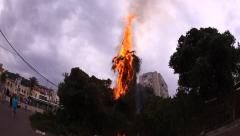 A tree was set on fire from miniature hot air balloons Stock Footage