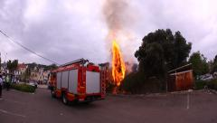 Fire squad to extinguish burning tree fire in 90 seconds Stock Footage