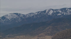 Snow Capped Desert Mountain Stock Footage