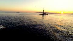 Take off and fly over Bosphorus Sea towards Maidens Tower at sunset. Stock Footage