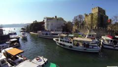 Take off and fly over Goksu River towards Anadolu Hisari Castle Stock Footage