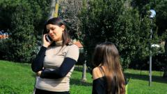 Teenager daughter convincing mother while on the phone to start to dance happ Stock Footage
