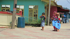 Children taking pictures and playing in a fisherman village (Malaysia) Stock Footage