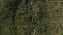 Waterfall stream trees cliff Stock Footage